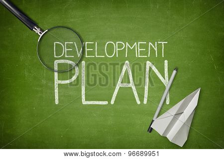 Development plan concept on green blackboard with empty paper sheet