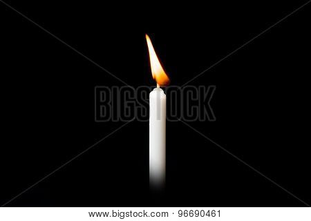 White Fire Burning Candle On Black Background.
