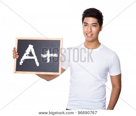 Asian man with chalkboard showing sign of A plus