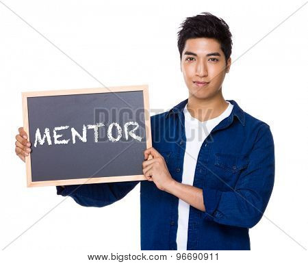 Asian mixed Indian man with blackboard showing a word mentor