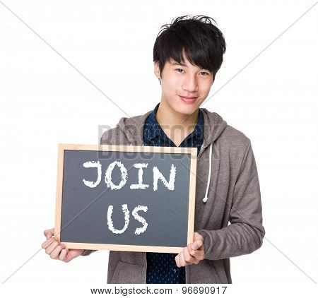 Asian young student with blackboard showing a phrase of join us