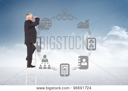 Mature businessman standing on ladder against cloudy sky background
