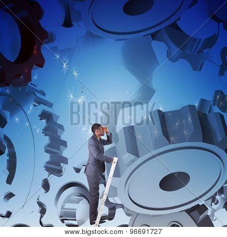 Businessman standing on ladder looking against digitally generated dandelion seeds against blue sky