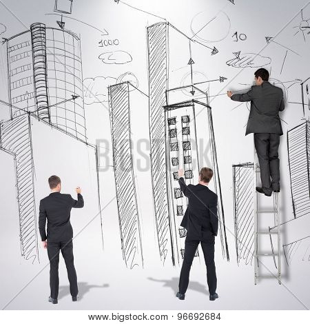 Business team writing against grey background
