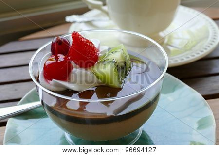 Chocolate Pudding Mousse Topping With Fruit And Whipped Cream