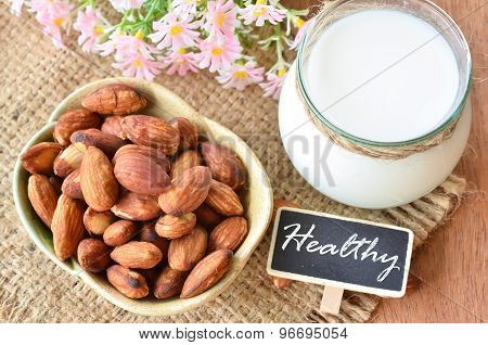 Almonds In Cup And Almond Milk In Glass.