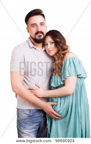 Pregnant Woman With Her Had On Husband Shoulder Isolated On White Background