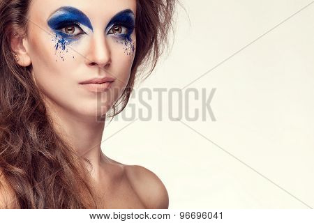 Woman With Blue Artistic Fashion Make Up