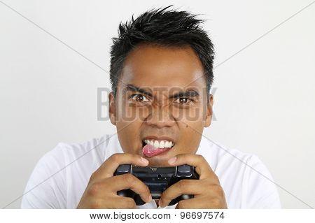 asian boy playing video games