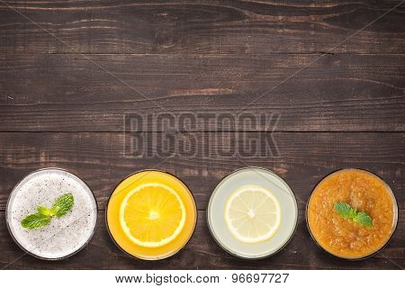 Set Of Fruit Smoothie And Juice In Glasses On Wooden Background With A Lot Of Copy Space For Your Te