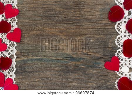 love background, little red hearts with rose petals on the wooden background