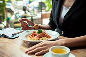 picture of meatball  - close up of woman eating spaghetti meatball - JPG