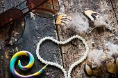 pic of dreamcatcher  - glasses earrings with feathers Dreamcatcher jewelry beads in the shape of a heart on a wooden background - JPG
