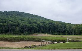 image of dock a lake  - Dried up lake with dock and mountain background - JPG