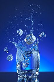 stock photo of liquid  - Water poured into a glass - JPG