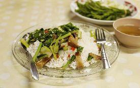 pic of crispy rice  - Thai food Fried kale with crispy pork on rice and soup - JPG