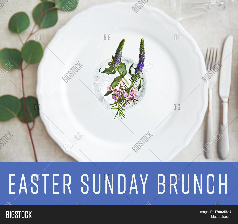 Text EASTER SUNDAY BRUNCH On Background. Elegant Table