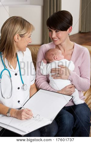 Mother With Newborn Baby Talking With Health Visitor At Home
