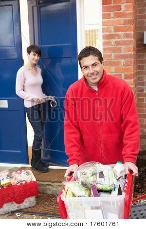 Home Delivery Grocery Driver Unloading Customer's Shopping