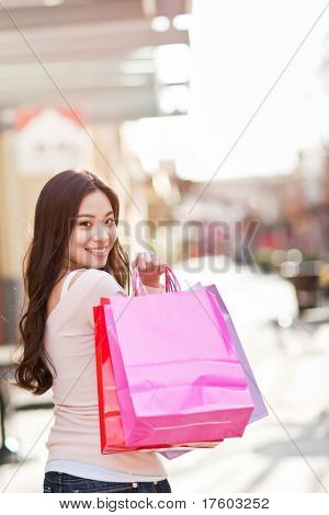 A shot of an asian woman shopping outdoor
