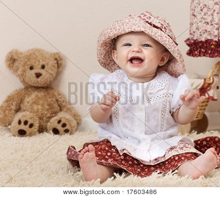 little child baby smiling playing in the room