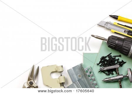 Plasterboard tools set with metal studs, screws, screwgun, cutter, punch lock crimper and tin snip cutter on white background