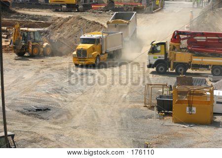 Trucks Rumble Into A Construction Site