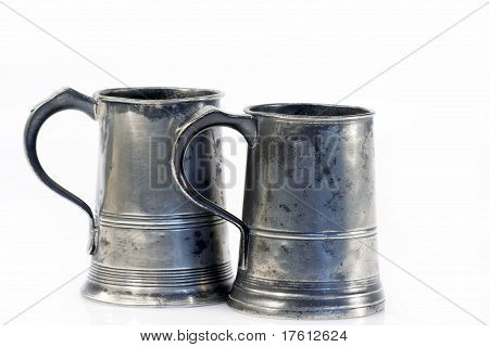 Two Old Quart Pewter Drinking Jars Isolated On White