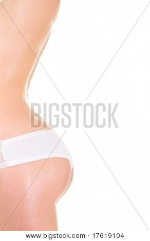 Slim woman in lingerie on the white background
