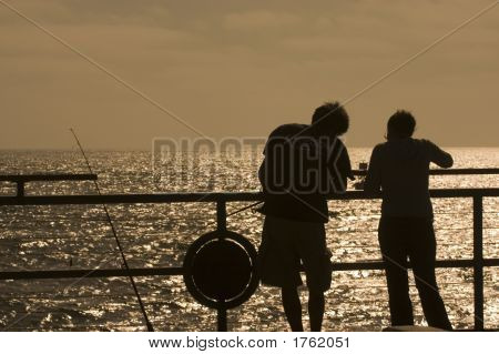 Young Couple Fishing Off The Pie