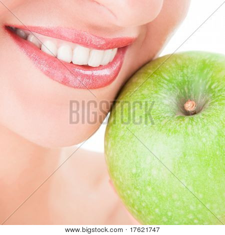 healthy teeth and green apple