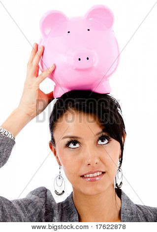 Business woman with a piggybank on top of her head balancing her finances