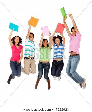 Excited group of students jumping - isolated over white