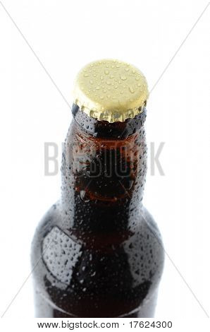 Closeup of a brown beer bottle cap and neck isolated on a white background. Vertical format with shallow depth of field.