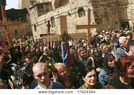 JERUSALEM - APRIL 21: Pilgrims come to Holy Sepulchre for pray, after a Crucession, in front of Temple, on Good Friday, April 21, 2006 in Jerusalem, Israel.