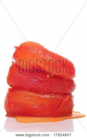 some whole peeled tomatoes on a white background