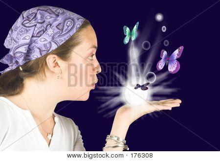 Beautiful Girl Blowing Butterflies - Mind Reader