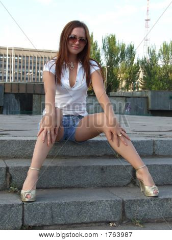 Beautiful Young Sexual Girl Sitting On The Stairs
