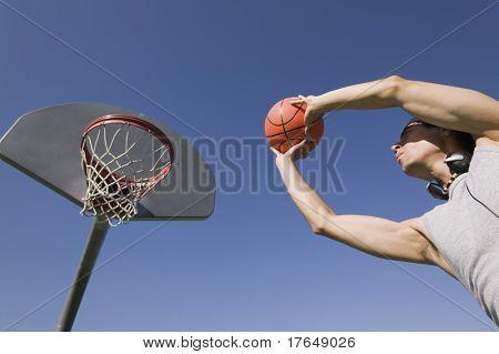Man Shooting Hoops