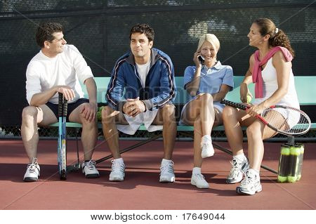 Couples on Tennis Court
