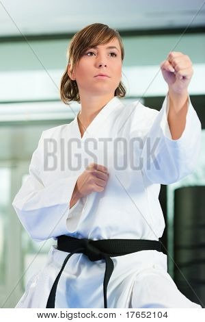 Young woman in martial art training in a gym