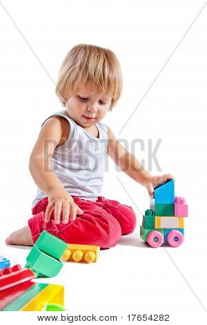 Cute Little Boy Playing With Toys