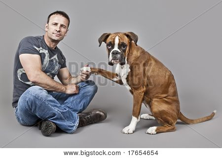 An image of a handsome muscle man with his dog