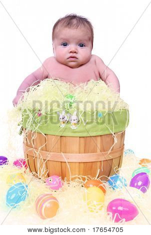 A cute young baby in an Easter basket during holiday