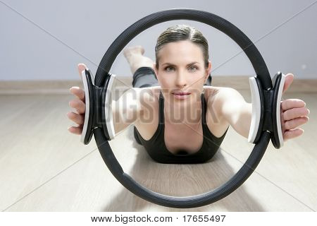 magic pilates ring woman aerobics sport gym exercises on wooden floor