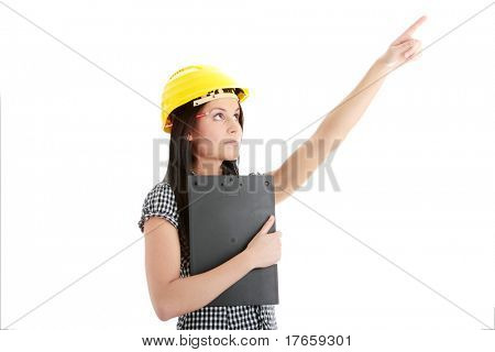 Engineer woman in yellow helmet pointing on something isolated on white background