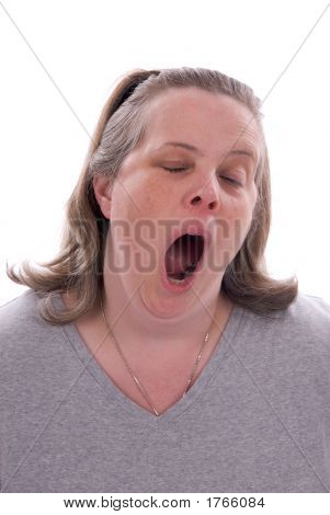 Middle-Aged Woman Yawning