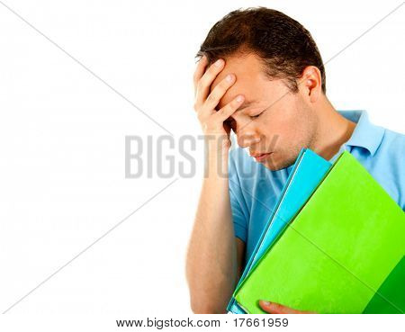 Frustrated male student with notebooks - isolated over a white background