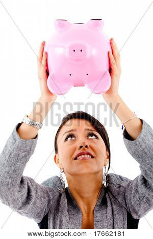 Desperate woman trying to take money out of a piggybank - isolated