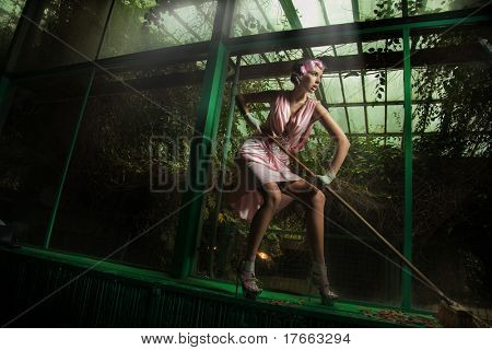 Cleaning woman wearing pink dress
